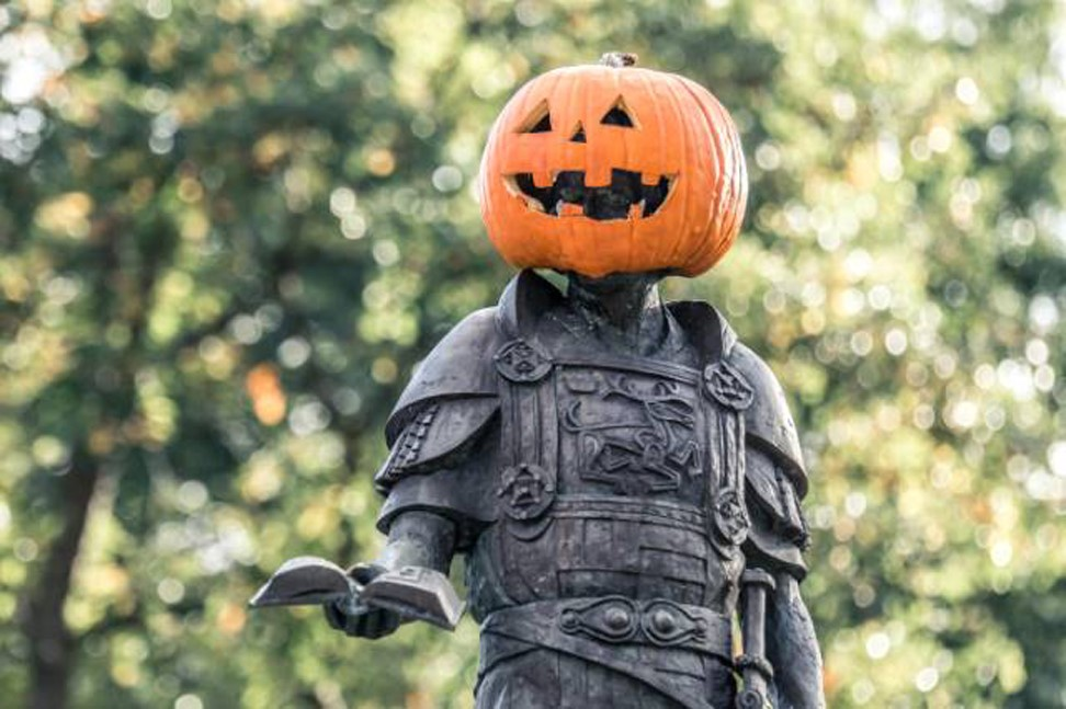 King Alfred statue with a carved pumpkin on his head